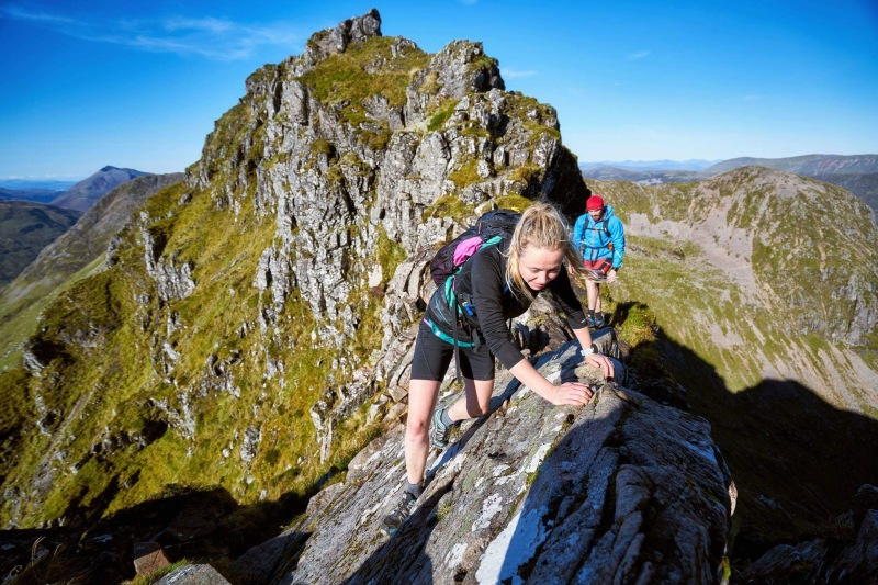 Hazel and Luke Robertson, Aonach Eagach ridge. Photo credit: Hamish Frost (Hamish Frost Photography)