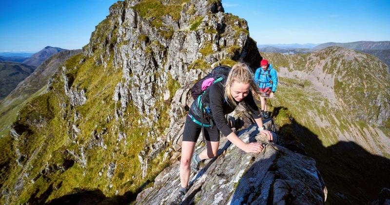 Hazel and Luke Robertson, Aonach Eagach ridge. Photo credit: Hamish Frost (Hamish Frost Photography)